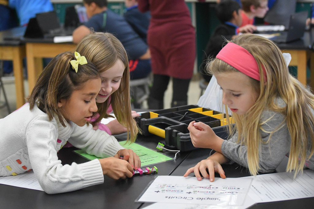 . Eric Bonzar�The Morning Journal<br> From left: Ten-year-old Isa Sikora, 9-year-old Julianna Stein and 9-year-old Emily Styers make a voice-activated fan using simple circuits during an Hour of Code, at Avon Heritage Elementary School, Dec. 12, 2017.