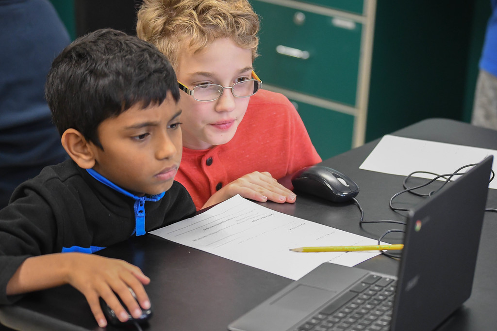 . Eric Bonzar�The Morning Journal<br> Partners David Mathew, 9, left, and 10-year-old Sammy Henry work together during an Hour of Code, at Avon Heritage Elementary School, Dec. 12, 2017.
