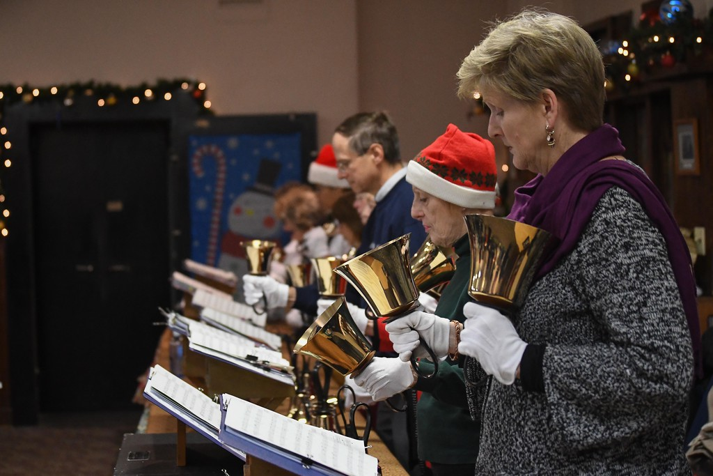 . Eric Bonzar�The Morning Journal<br> St. Peter\'s United Church of Christ Bell Choir performs holiday tunes during Main Street Amherst\'s Lolly the Trolley event, Dec. 13, 2017.