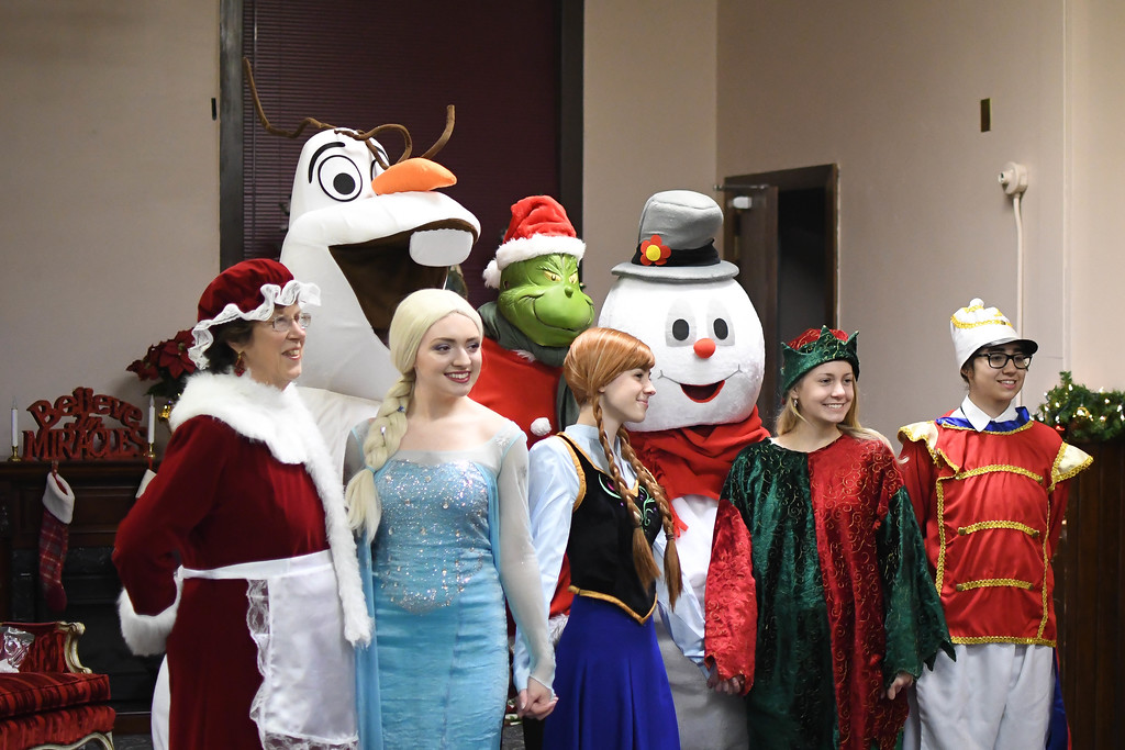 ". Eric Bonzar�The Morning Journal<br> Guests were treated with appearances from holiday classics such as Frosty the Snowman and characters from Disney\'s ""Frozen,\"" during Main Street Amherst\'s Lolly the Trolley event, Dec. 13, 2017."