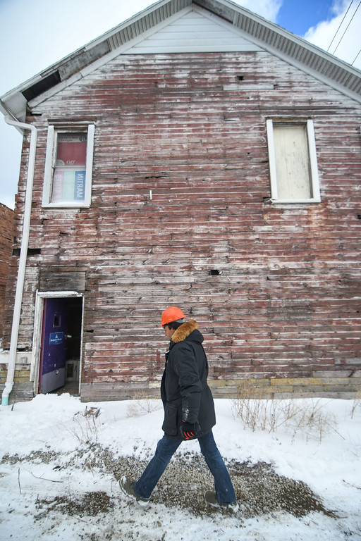 . Eric Bonzar�The Morning Journal<br> With warrant in hand, Housing Inspector Eric Elmi enters the rear of Nelis Wallpaper, 858 Broadway Ave., Dec. 14, 2017, for an inspection. The building and its owner have currently come under fire from Lorain Growth Corp., and others invested in the revitalization of downtown Lorain, who have called upon the city�s building inspectors to hold property owners accountable for the deteriorating conditions of their buildings located along Broadway.
