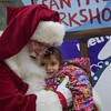 "Eric Bonzar—The Morning Journal<br> Two-year-old Kadence Swiger gets a hug from ""Santa"" during Metro PCS 225 E. 42nd St. location's customer appreciation holiday party, Dec. 15, 2017."