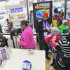 Eric Bonzar—The Morning Journal<br> Families pack Owner Moe Haq's 225 E. 42nd St. Metro PCS location to benefit from the store owner's generosity during the store's customer appreciation holiday party, Dec. 15, 2017.