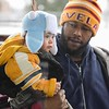 "Eric Bonzar—The Morning Journal<br> One-year-old Xavier Grantham and his father, Anthony Grantham Jr., wait outside of Metro PCS, 225 E. 42nd St., to see ""Santa"" during the store's customer appreciation holiday party, Dec. 15, 2017."