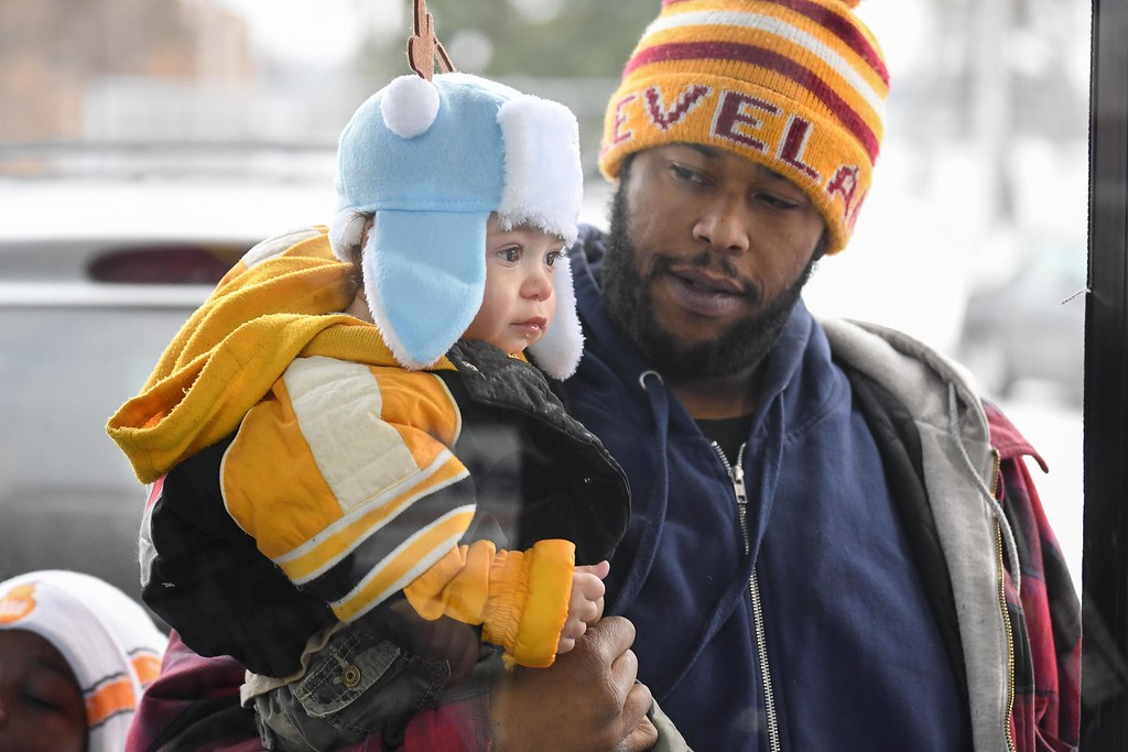 ". Eric Bonzar�The Morning Journal<br> One-year-old Xavier Grantham and his father, Anthony Grantham Jr., wait outside of Metro PCS, 225 E. 42nd St., to see ""Santa\"" during the store\'s customer appreciation holiday party, Dec. 15, 2017."