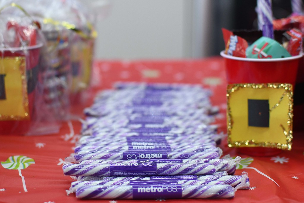 . Eric Bonzar�The Morning Journal<br> Branded candy sticks and other treats were available to families attending the 225 E. 42nd St. Metro PCS location\'s customer appreciation holiday party, Dec. 15, 2017.
