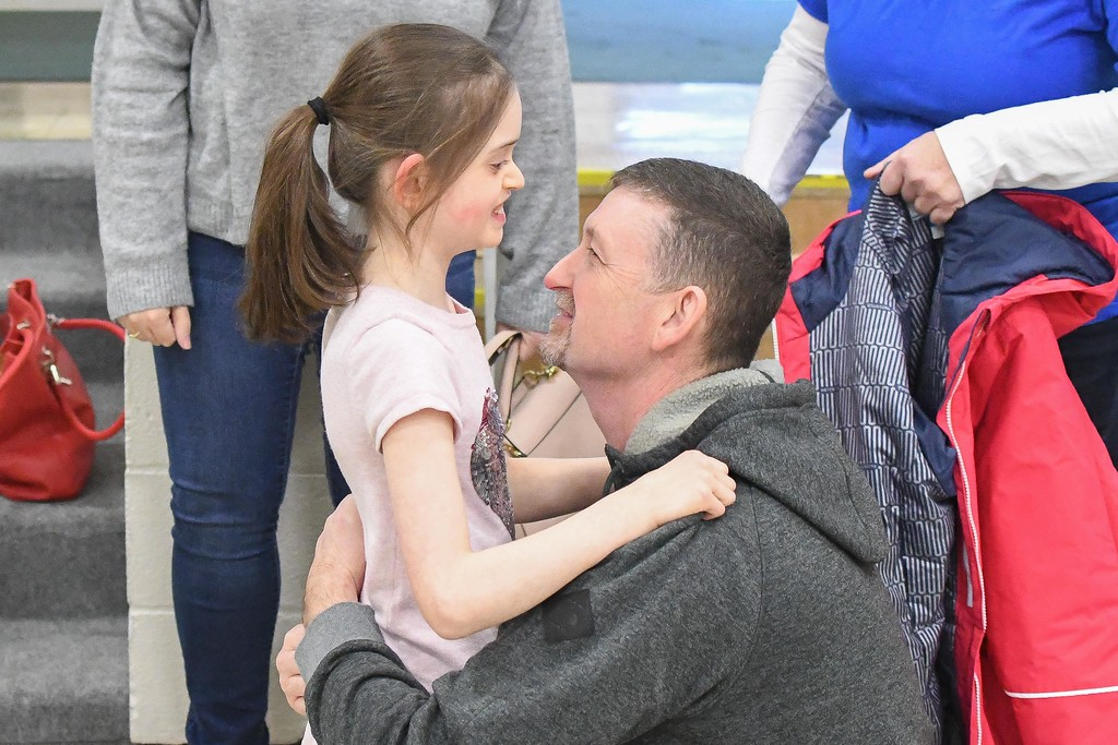 . Eric Bonzar�The Morning Journal<br> Ten-year-old Makenzie Dvorscak hugs her father Wayne, after seeing her new Amtryke therapeutic tricycle, Dec. 19, 2017. Members of the North Ridgeville Kiwanis Club surprised the Murray Ridge School student with her new ride, Tuesday afternoon, in the school\'s gymnasium.