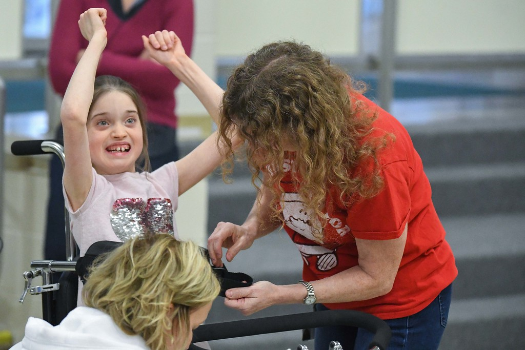 . Eric Bonzar�The Morning Journal<br> Ten-year-old Makenzie Dvorscak pumps her fists in the air, in excitement, as she is secured in her new Amtryke therapeutic tricycle, Dec. 19, 2017. Members of the North Ridgeville Kiwanis Club surprised the Murray Ridge School student with her new ride, for the holidays.