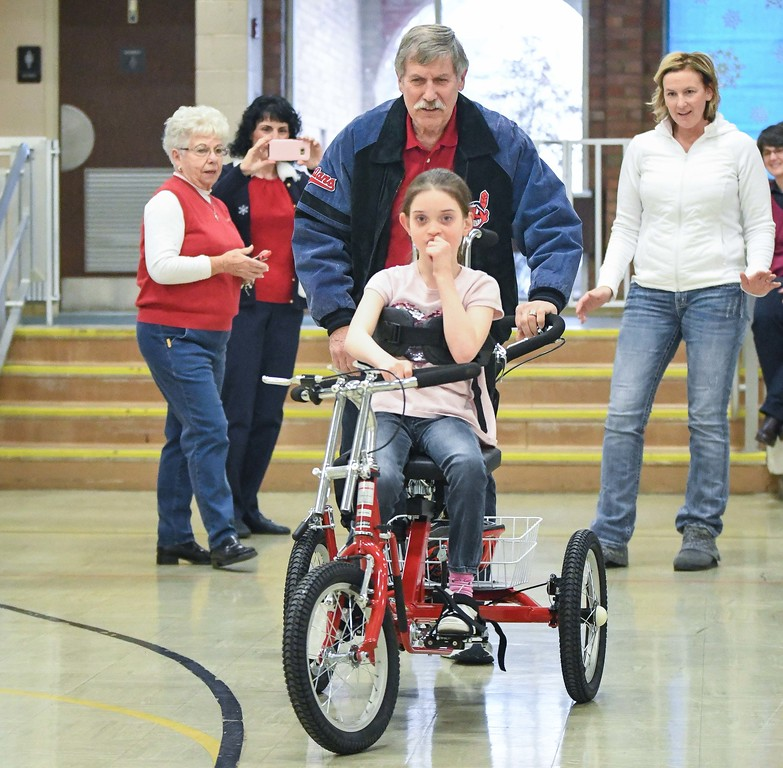 . Eric Bonzar�The Morning Journal<br> Ten-year-old Makenzie Dvorscak takes a spin on her new Amtryke therapeutic tricycle, for the first time, with North Ridgeville Kiwanis Club honorary member Lee Fenrich, Dec. 19, 2017.