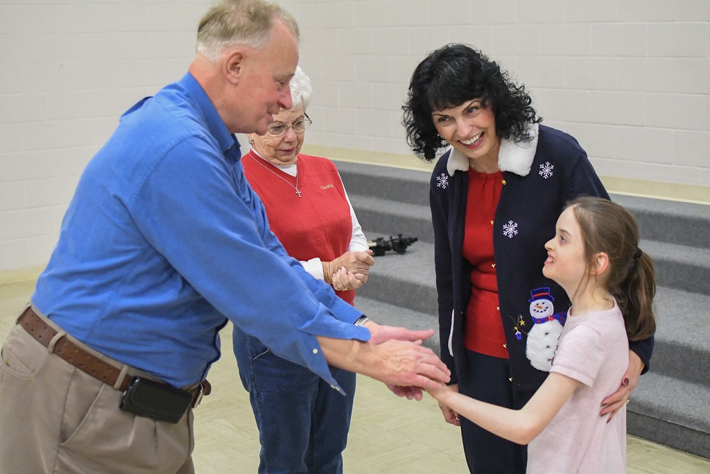 . Eric Bonzar�The Morning Journal<br> Ten-year-old Makenzie Dvorscak meets North Ridgeville Kiwanis Club members Robert Williams, Vee Reifsnyder, center, and Cindy Hemsoth in the gymnasium of Murray Ridge School, Dec. 19, 2017. Members of the club surprised the Murray Ridge School student with a new Amtryke therapeutic tricycle, for the holidays.