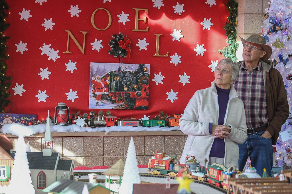 . Eric Bonzar�The Morning Journal<br> Train enthusiast and displayer Rich Papay and his wife Helga, of Amherst, admire the train making its way above head, Dec. 19, 2017. The International Tree and Model Train Display, 421 Black River Lane, in Lorain, continues through Dec. 30. Guests are encouraged to attend the Black River Landing event from 5-9 p.m., Fri. and Sat. and 3-7 p.m., Sun. The display is free to the public, and will be closed Dec. 24.