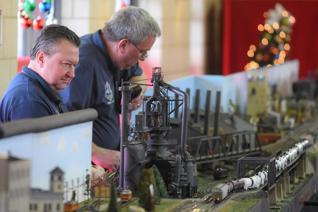 . Eric Bonzar�The Morning Journal<br> Gary Schaefer, left, and Lee Sheffield, of the National Model Railroad Association\'s Mid-Central Region, Division 4, keep an eye on their train set as it makes its way along the tracks, Dec. 19, 2017. The International Tree and Model Train Display, 421 Black River Lane, in Lorain. The event continues through Dec. 30 from 5-9 p.m., Fri. and Sat. and 3-7 p.m., Sun. The display is free to the public,  and will be closed Dec. 24.