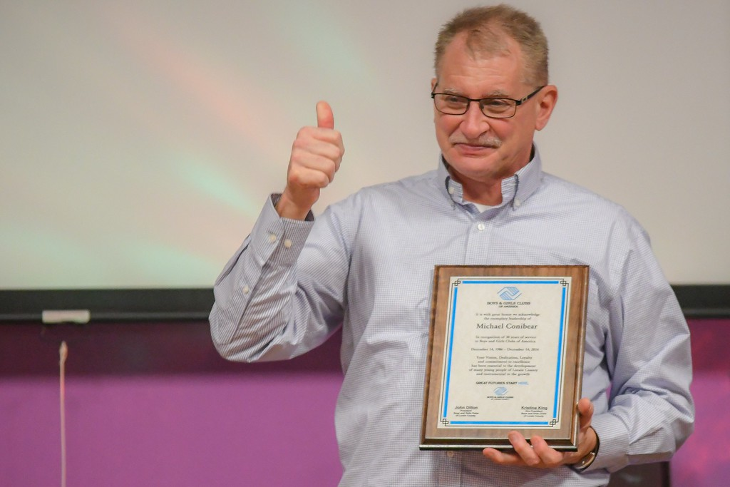 . Eric Bonzar�The Morning Journal Lorain County Boys and Girls Clubs Executive Director Mike Conibear gives a thumbs up after being recognized for 30 years of service, during the organization\'s staff appreciation luncheon, Dec. 22, 2016.