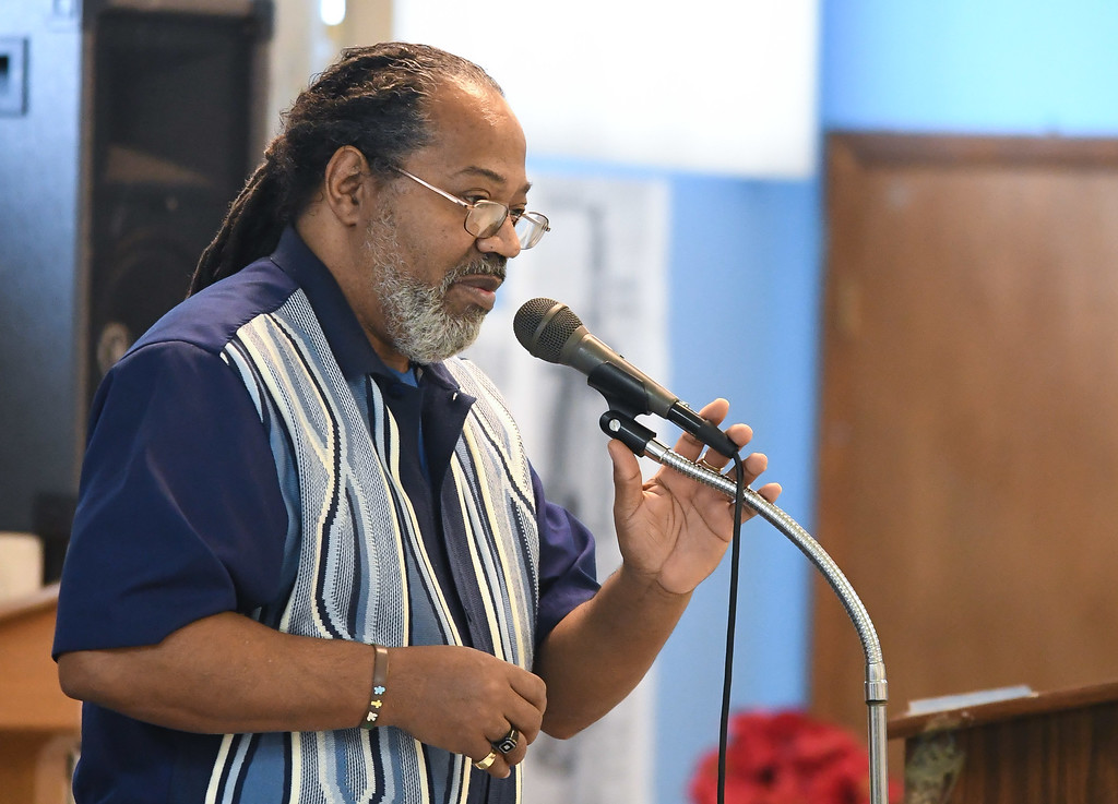 . Eric Bonzar�The Morning Journal<br> Associate pastor Rev. Gregory Bryant says a prayer to bless the food during Second Baptist Church\'s Kwanzaa celebration, in Lorain, Dec. 26, 2017.