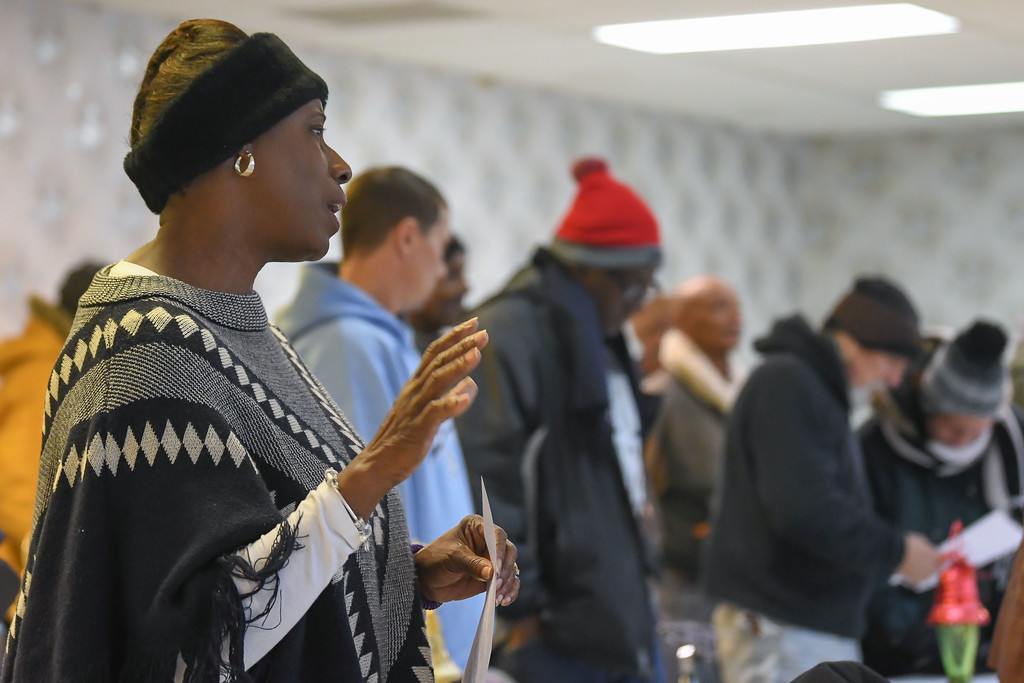 """. Eric Bonzar�The Morning Journal<br> Artie Lewis, wife of Rev. Loversier Lewis, sings James Weldon Johnson\'s \""""Lift Every Voice and Sing,\"""" during Second Baptist Church\'s Kwanzaa celebration, in Lorain, Dec. 26, 2017."""