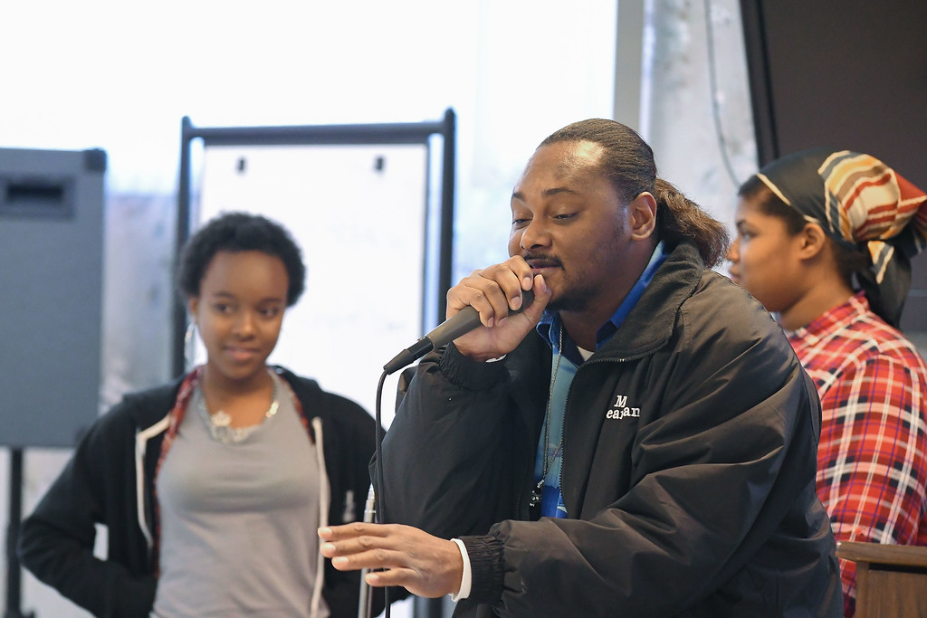 """. Eric Bonzar�The Morning Journal<br> Rapper Worth Beaman III, and singers Tiaira Wyatt, left, and Madajia King, 17, perform Beaman\'s original song \""""Together\"""" during Second Baptist Church\'s Kwanzaa celebration, in Lorain, Dec. 26, 2017."""