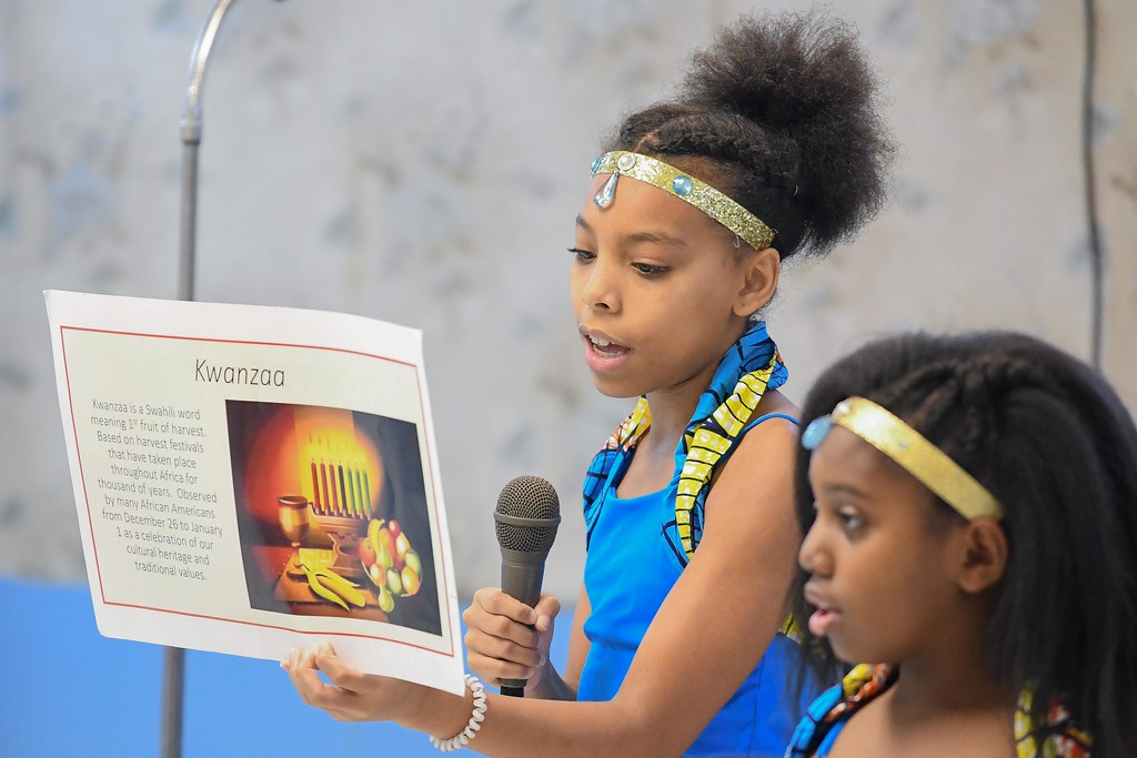 . Eric Bonzar�The Morning Journal<br> Thirteen-year-old Niyere Chambers, member of the African Royalty Dancers, recites the meaning of Kwanzaa during Second Baptist Church\'s Kwanzaa celebration, in Lorain, Dec. 26, 2017.