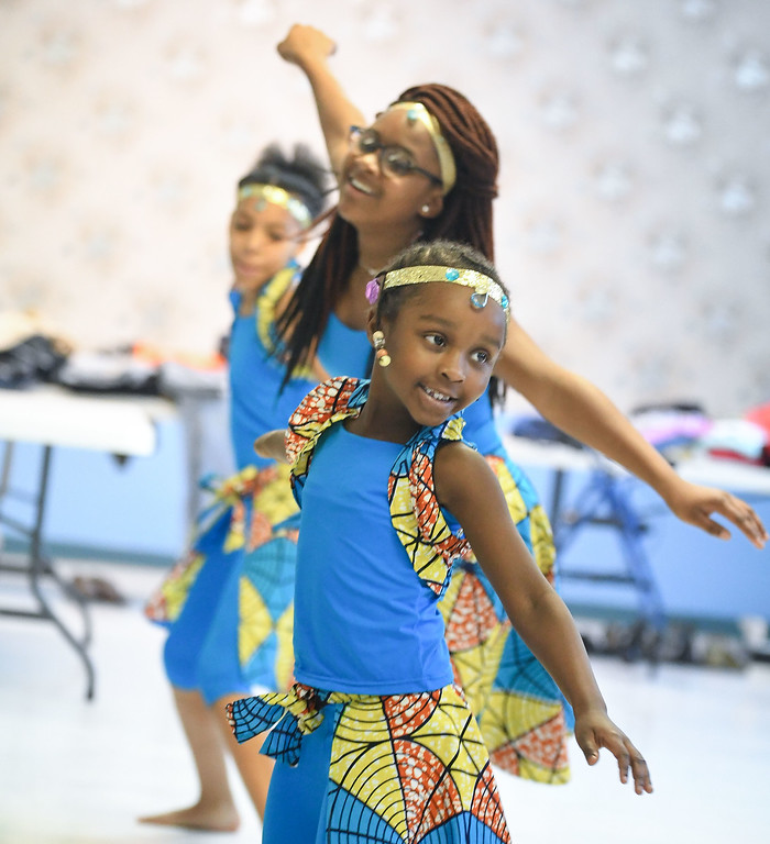 . Eric Bonzar�The Morning Journal<br> Six-year-old Aaliyah Gaddie and her fellow African Royalty Dancers perform for guests of Second Baptist Church\'s Kwanzaa celebration, in Lorain, Dec. 26, 2017.