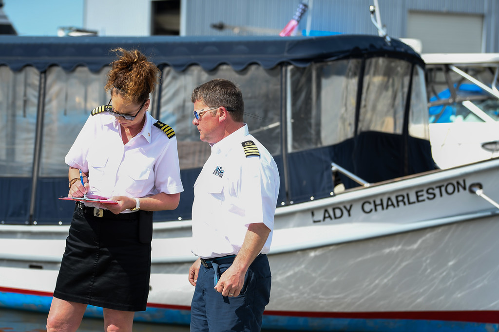 ". Eric Bonzar�The Morning Journal Captains Susan Scott and Corey Wisniewski perform an equipment check on the 26-foot charter boat, ""Pride of Lorain\"" on April 26, 2017. The Lorain Port Authority will utilize its two riverboats, the \""Pride of Lorain\"" and \""Lady Charleston\"" to offer 130 scheduled riverboat tours this year."