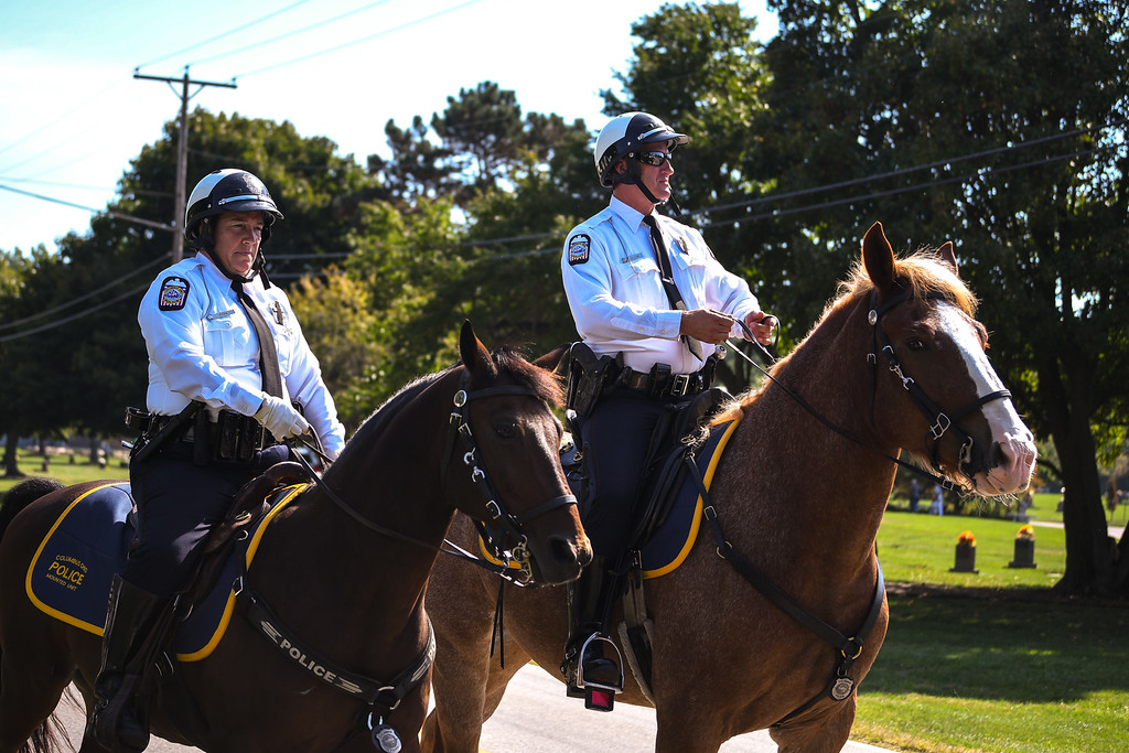 . Eric Bonzar�The Morning Journal Mounted police officers stand in line as they wait for the arrival of  the funeral procession for Ohio State Highway Patrol Trooper Kenneth Velez, Sept. 22, 2016.