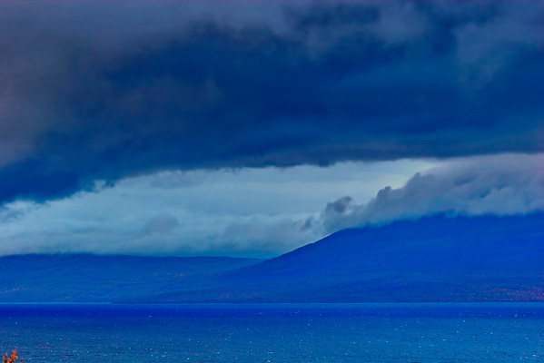 Storm clouds are darkening the sky over lake Torneträsk