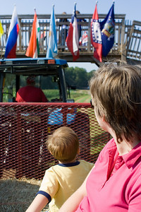 K.C. rides under the corn maze arch on the hay ride with Mom.