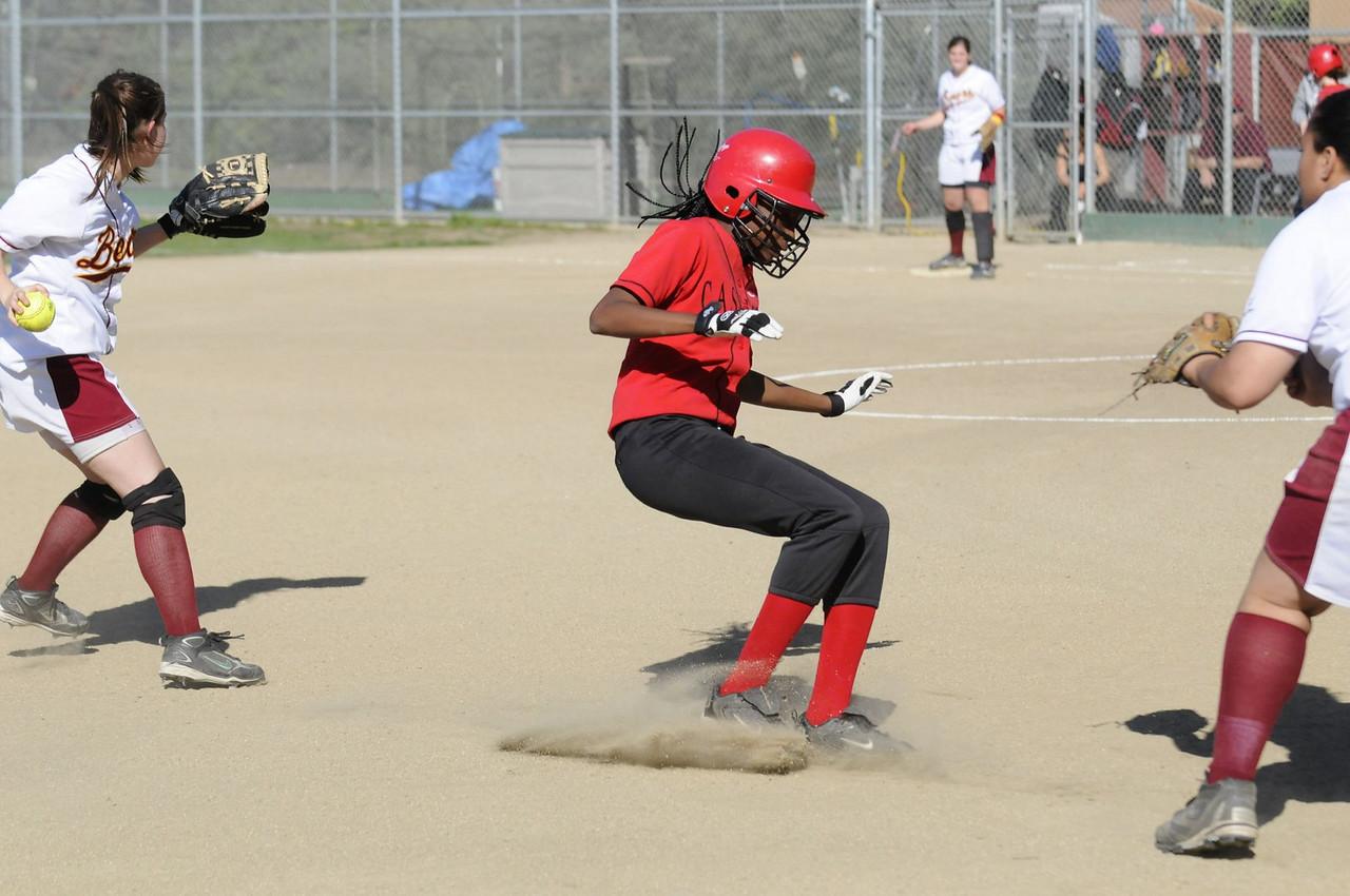 Castilleja Softball 1/ 8000s, at f/4    E.Comp:0    82mm    WB: AUTO 0.    ISO: 800    Tone:     Sharp:     Camera: NIKON D300on: 2009:03:19 16:15:26