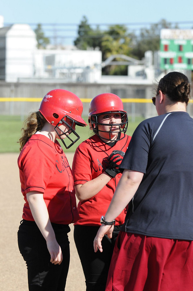 Castilleja Softball 1/ 3000s, at f/4 || E.Comp:0 || 102mm || WB: AUTO 0. || ISO: 400 || Tone:  || Sharp:  || Camera: NIKON D300on: 2009:03:27 16:37:38