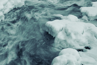 Söderåforsen på vintern - Ice growing on the banks of a white water river - monochrome