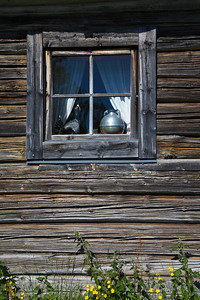 Window in an old wooden log cabin