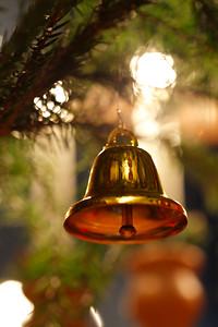 Julpynt -  Bell hanging in a fir tree