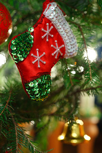 Julpynt -  Christmas stocking hanging in a fir tree