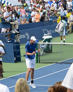 John Isner celebrating win over Djokovic