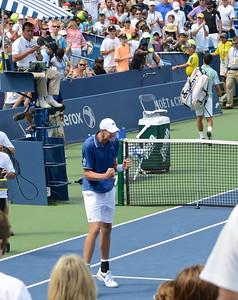 John Isner celebrating win over Djokovic