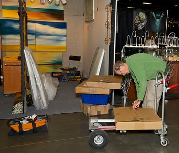 Artists finish their  set up on Friday afternoon before the grand opening event
