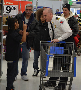 Assistant Fire Chief Steve Densmore listens to the child he's paired with.
