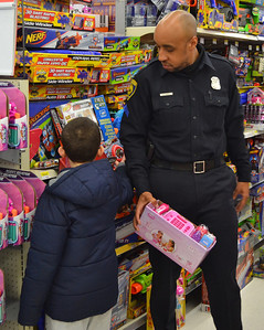 Police Cpl. Marvin Sanders looks at toys.