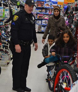 Police Cpl. Todd Donaldson and the family he's paired with enjoy the bicycle aisle.