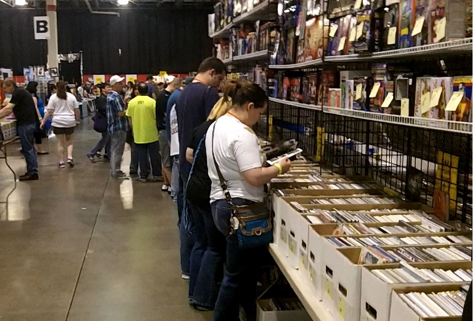Description of . Fans from all over the state came to shop for deals from comic vendors. Photo by David Komer