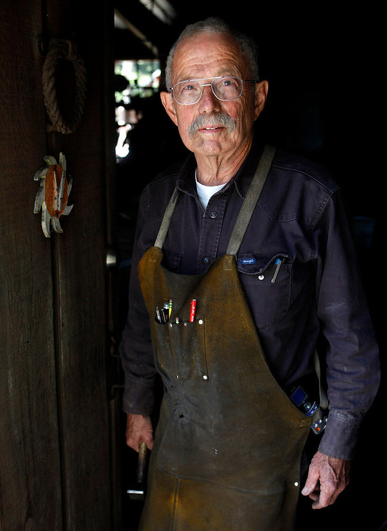 . Blacksmith John Hudson, 78, stands at the doorway to his shop across from Point Lobos in Carmel, Calif. on Wednesday August 21, 2013.  (Photo David Royal/ Monterey County Herald)