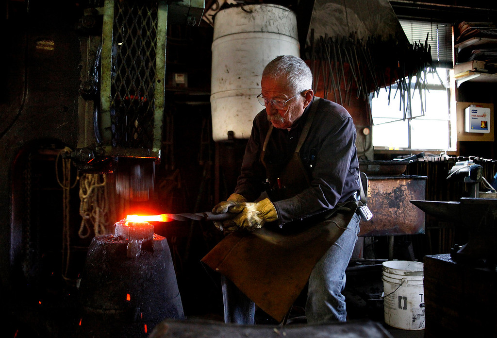 . Blacksmith John Hudson, 78, uses a forging hammer at his shop across from Point Lobos in Carmel, Calif. on Wednesday August 21, 2013.  (Photo David Royal/ Monterey County Herald)