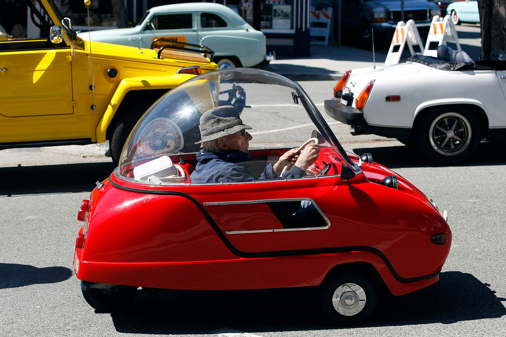 . Dick Tuttle arrives in his 1964 Peel Trident to the Little Car Show on Lighthouse Avenue in Pacific Grove on August 14, 2013.  Tuttle\'s car is the only known Trident west of the Mississippi in the 50cc class.  (Vern Fisher/Monterey County Herald)
