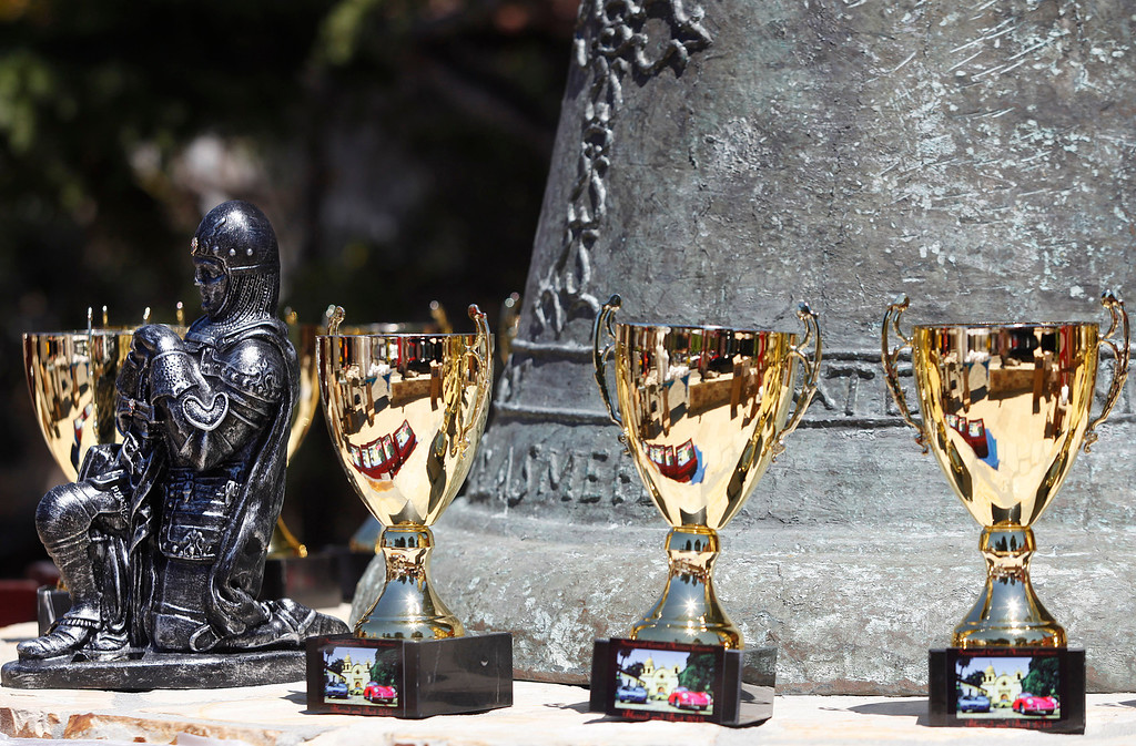 . The Knight of Columbus best of show trophy sits next to other category winner trophies during the Blessing of the Cars at Carmel Mission in Carmel, Calif. on Wednesday August 14, 2013.   (Photo David Royal/ Monterey County Herald)