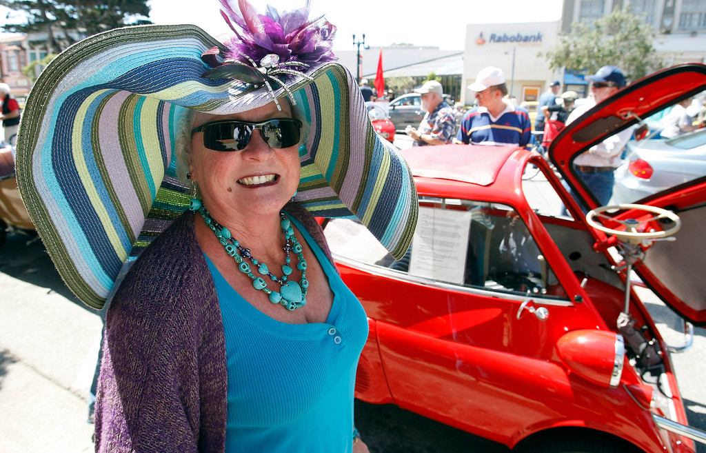 ". Cecelia Knauf with her 1958 BMW Isetta 300 that she named ""BEEPOOP\"" at The Little Car Show on Lighthouse Avenue in Pacific Grove on August 14, 2013.  (Vern Fisher/Monterey County Herald)"