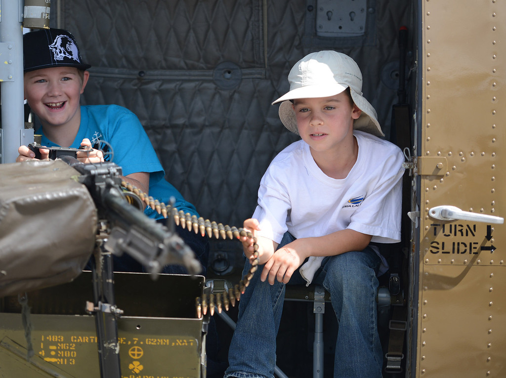 . Cole Brewer and his friend Quentin Williams, both 8, of Prunedale play with a M-60 Machine Gun inside a Huey EMU 309 helicopter during the California International Airshow Salinas at the Salinas Airport in Salinas, Calif. on Saturday September 21, 2013. The restored helicopter first flew in Vietnam in 1965 and serves as an active tribute to those who served as part of Hueyvets.com. (Photo David Royal/ Monterey County Herald)