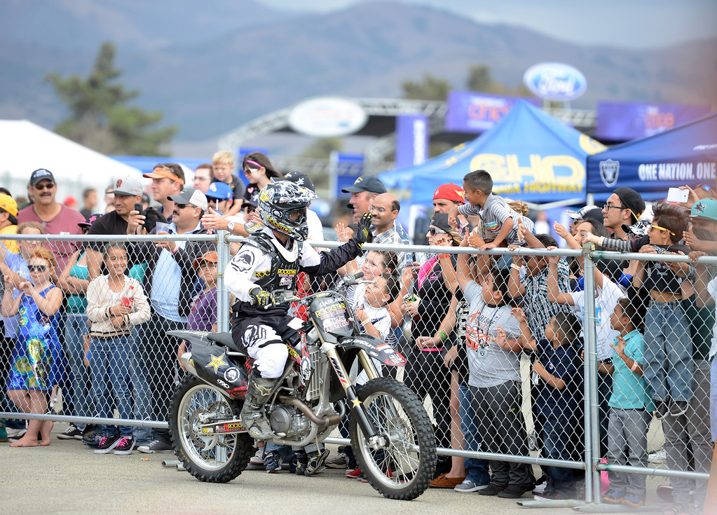 . Fans gather to greet Metal Mulisha riders after they performed tricks on their motorcycles during the California International Airshow Salinas at the Salinas Airport in Salinas, Calif. on Saturday September 21, 2013.  (Photo David Royal/ Monterey County Herald)