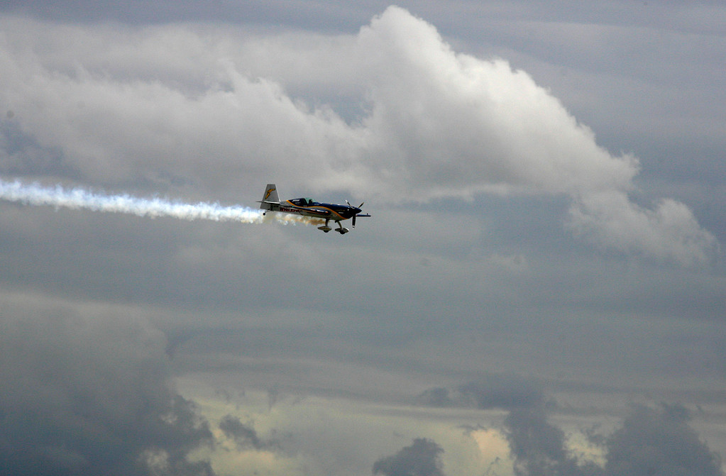 . Michael Goulan soars through cloudy skies in his Extra 330SC during the California International Airshow Salinas at the Salinas Airport in Salinas, Calif. on Saturday September 21, 2013.  (Photo David Royal/ Monterey County Herald)
