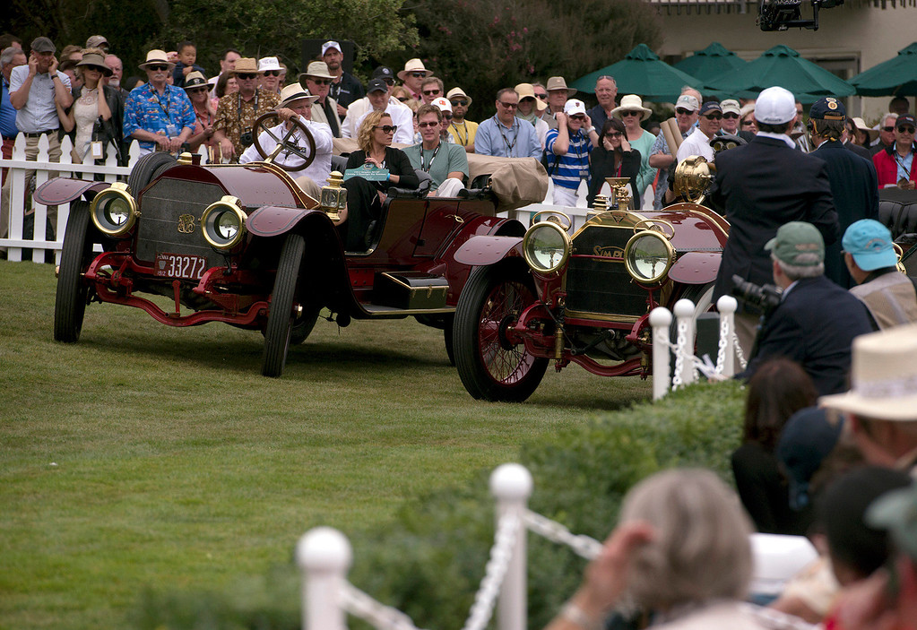 . Spectators cover their ears as two early 1900\'s Simplex automobiles backfire at the 2013 Concours d\'Elegance. (Matthew Hintz/Monterey County Herald)