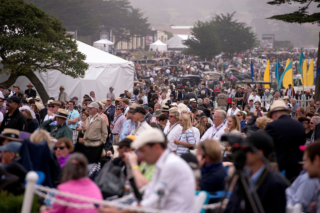 . Cars and people sprawl across the 18th hole at Pebble Beach golf course Sunday, August 18th, 2013 during the 2013 Concours d\'Elegance. (Matthew Hintz/Monterey County Herald)