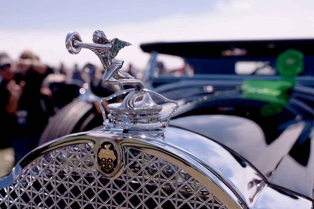 . The hood ornament on a 1931 Packard 840 Custom 8 Sport Phaeton sparkles on the 18th fairway of Pebble Beach Sunday, August 18th, 2013 during the 2013 Concours d\'Elegance. (Matthew Hintz/Monterey County Herald)